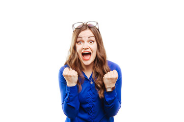 Image of excited screaming young woman standing isolated over white background. Looking camera.