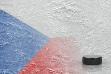 Hockey puck and the image of the Czech flag on the ice