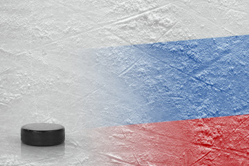 Hockey puck and Russian flag on ice