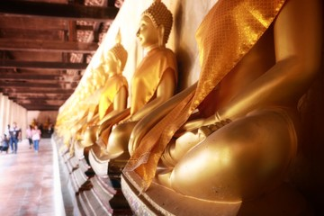 Buddha image god within gold colored in the ayutthaya historical park Thailand