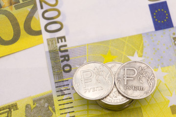 coin one ruble and the European currency: banknotes of five and fifty euro coins .