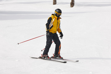 Adult skiing on a snowy hill landscape. Winter sport