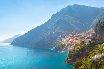 Morning view of Positano cityscape on coast line of mediterranean sea, Italy