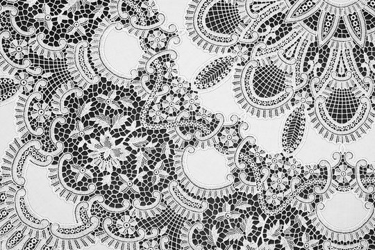 Detail of an old hand-embroidered lace table cloth.