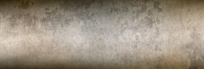 Etwas Sonnenlicht fällt auf eine Textur einer alten Betonwand - als Hintergrund