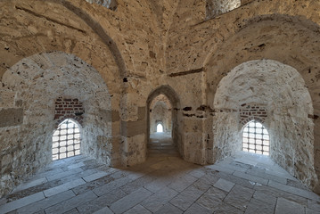 Three arches leading to windows on brick stone wall of a passage surrounding the Citadel of Qaitbay, Alexandria, Egypt