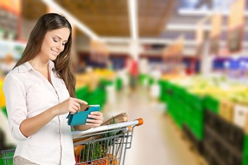 Young happy woman with shopping cart