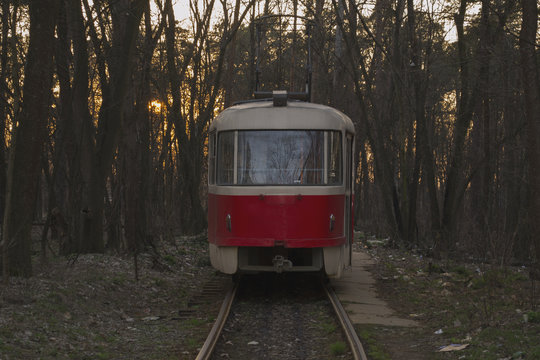 Vintage tram staying on a railroad station.