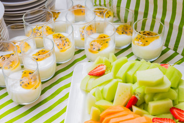 Breakfast yogurt and fruit salad - Passion fruit yogurt in clear glass at Spring Festival picnic event
