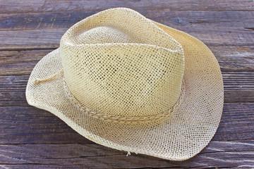 Straw summer hat on wooden background