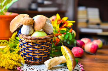 Basket with white mushrooms on table
