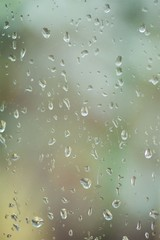Rain drops or condensation on the glass. It is a cold autumn or winter