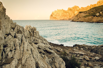 Cliffs and bay in Cala Sant Vincenc, Majorca, Spain, Europe, during the sunset