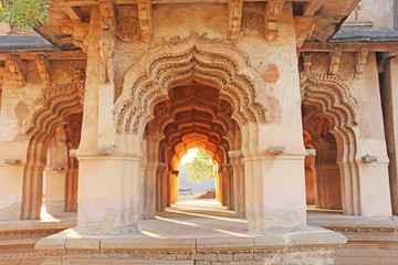 Lotus Mahal Temple in Hampi, Karnataka, India. Beautiful carved stone arch and sunset. A popular tourist route from the GOA state. Beautiful hindu temple Wall mural
