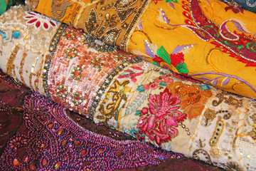 Sari. Bright colored fabrics India. It is built on the market. Hand Embroidery India. Tablecloths of different colors are sold at the bazaar in India, Goa