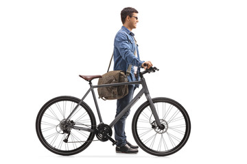 Young man with a bicycle waiting in line