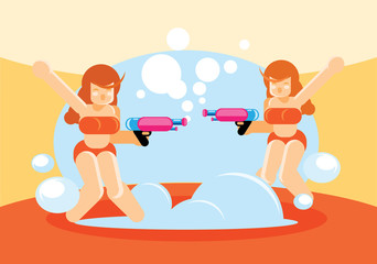 two pretty girl playing bubble gun in summer
