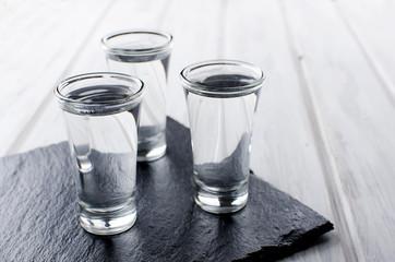 Vodka shots on white table