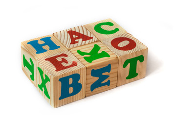 wooden toy cubes with letters isolated on white background