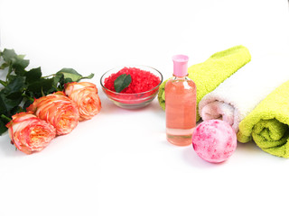 Sea salt, towels,dry bath bomb, tea candles, aroma oil in bottles and lavender on background.Flat lay. Spa cosmetic products.Spa treatments. Spa and wellness setting with flowers and towels. Dayspa