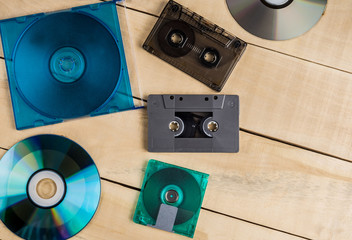 cassette disks floppy disks for music lie on a wooden table
