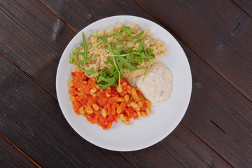 Baked beans and carrot with couscous on a table