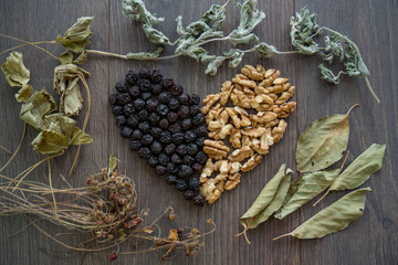 heart of dried cherries, nuts and dried leaves of tea