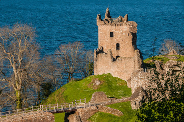 Urquhart Castle sits beside Loch Ness in the Highlands of Scotland overlooking the Urquhart Bay on the Loch.