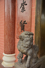 Guardian Lion or Foo Dog at the entrance to the historic Hainan Assembly Hall in the UNESCO listed central Vietnamese town of Hoi An