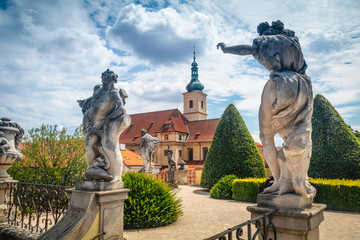 Summer view on Statues and st. Nicholas church of Vrtba garden (18th century), Prague