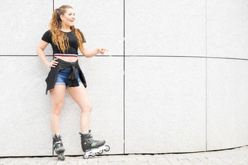 Young woman riding roller skates
