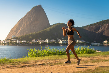 Young Fitness Woman Running on a Dirt Road in the Morning, Sugarloaf Mountain in the Horizon