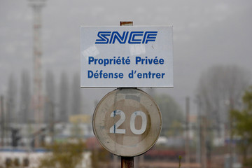 A sign with a SNCF railway logo is seen at a marshalling yard in Sotteville-Les-Rouen