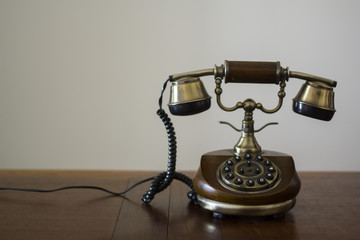 Vintage phone on wooden table