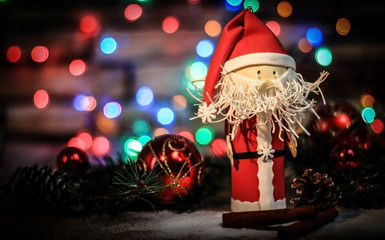 toy Santa Claus on a Christmas background