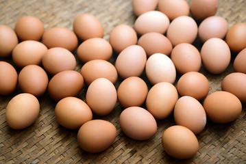 Fresh farm eggs on a wooden background