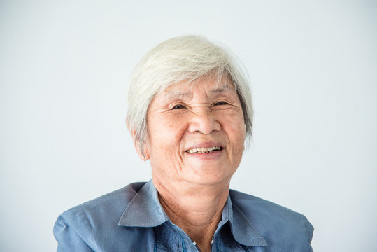 Closeup senior asian female with white color hair smiling at camera