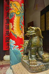 Guardian Lion, or Foo Dog, in the Phuoc Kien (or Fukian, Fujian or Phuc Kien) Assembly Hall built in 1697 by Chinese merchants in the historic UNESCO listed central Vietnamese town of Hoi An