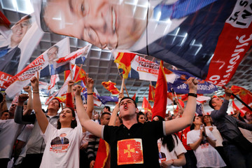 Supporters of Milo Djukanovic, the presidential candidate of the ruling DPS party (Democratic party of Socialists), attend a rally in Podgorica