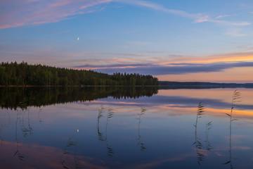 Colorful summer night lake landscape after sunset