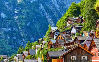 Hallstatt, Austria. Vintage wooden houses on slopes knolls banks