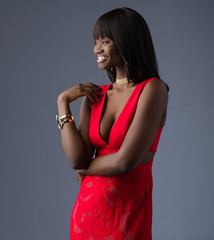 Beautiful African Model Posing in a Red Dress Smiling - Three Quarters