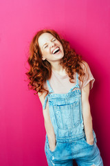 Young laughing woman wearing overalls
