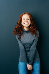 Portrait of cheerful young red-haired woman