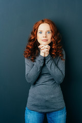 Eager excited young redhead woman