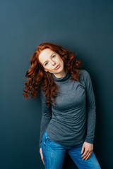 Serious intense young redhead woman