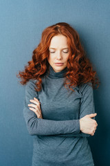 Melancholy lonely young redhead woman