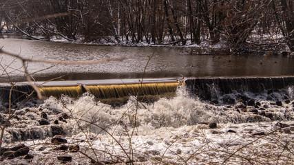 Winter river scene with dam
