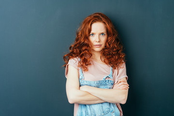 Serious thoughtful young redhead woman