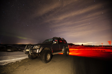 A jeep at night in Iceland